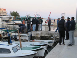 The reappearance of fishermen in the harbor often attract curious people